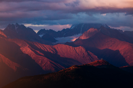 A look at the grand ridges at twilight. Location Upper Svaneti, Georgia country, Europe. Main Caucasian ridge. Scenic image of wild area. Discover the beauty of earth. Impressive adventure wallpapers