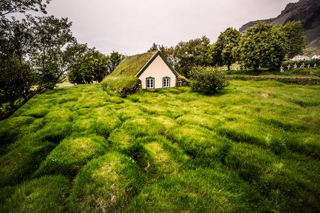 Amazing view of turf church Hofskirkja. Location place of Iceland, small village Hof, Europe. Scenic image of beautiful nature landscape. Attractive summer scene. Discover the beauty of earth. Reklamní fotografie - 123399800