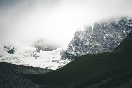 Grand cliffs near Mt Ushba. Location Upper Svaneti, Georgia country, Europe. Main Caucasian ridge. Scenic image of lifestyle hiking concept. Adventure summer vacations. Explore the beauty of earth. Banco de Imagens
