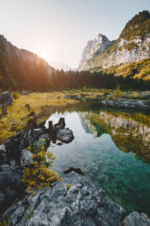 Scenic image of great alpine lake Vorderer Gosausee. Salzkammergut is a famous resort area located in the Gosau Valley in Upper Austria. Dachstein glacier. Explore the beauty of earth. Moody picture.