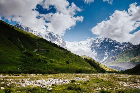 Grand cliffs near Mt Tetnuldi. Location Upper Svaneti, Georgia country, Europe. Main Caucasian ridge. Scenic image of lifestyle hiking concept. Adventure summer vacations. Explore the beauty of earth Banco de Imagens