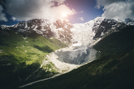 Fantastic snow peaks at the foot of Tetnuldi glacier in the morning light. Location Svaneti, Georgia country, Europe. Main Caucasian ridge. Scenic image of wild area. Discover the beauty of earth.