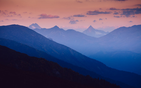 A look at the grand ridges at twilight. Location Upper Svaneti, Georgia country, Europe. Main Caucasian ridge. Scenic image of wild area. Discover the beauty of earth. Excellent adventure wallpapers.