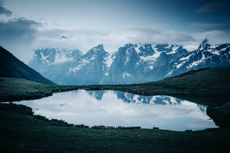 Lake Koruldi near Mt. Ushba. Location Upper Svaneti, Georgia country, Europe. Main Caucasian ridge. Scenic image of lifestyle hiking concept. Great photo of wild area. Explore the beauty of earth. Banco de Imagens