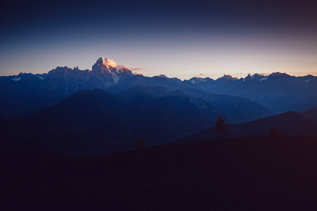 A look at the grand ridges that lights up. Location Svaneti, Georgia country, Europe. Main Caucasian ridge. Scenic image of wild area. Discover the beauty of earth. Excellent adventure wallpapers.