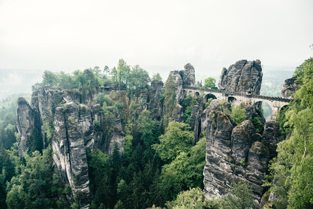 Scenic image of Elbe Sandstone Mountains. Location Saxony Switzerland national park, Bastei bridge, East Germany, Europe. Popular tourist attraction. Adventure vacation. Discover the beauty of earth.