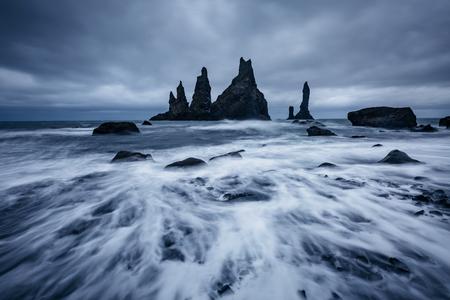 Scenic image of incredible nature landscape. Reynisdrangar basalt rocks or Troll toes. Location Reynisfjara Beach, Atlantic ocean near Vik, Iceland (Sudurland), Europe. Discover the beauty of earth. Stok Fotoğraf