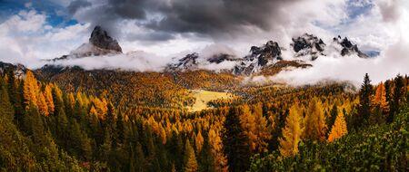 Stunning image of the alpine wallpaper. Dramatic scene, gloomy weather. Location famous place National Park Tre Cime di Lavaredo, Misurina, Dolomiti alps, South Tyrol, Italy, Europe. Beauty world. Banco de Imagens - 129813750