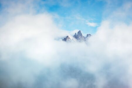 Foggy hill and stunning scene of the alpine valley. Location Dolomiti, South Tyrol, Dramatic day and picturesque image. Climate change. Save environment. Drone photography. Explore the worlds beauty.