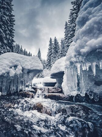Scenic image of stormy flow. Frozen stones in frosty day. Location Carpathian, Ukraine country, Europe. Great picture of wilderness. Explore the beauty of earth. Incredible holiday wallpapers.