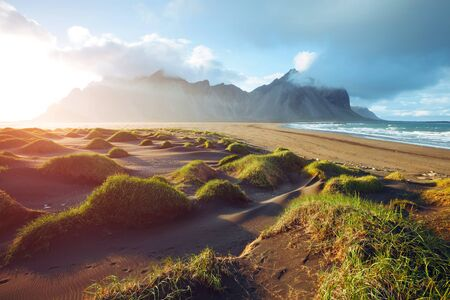 Majestic landscape on sunny day. Location Stokksnes cape, Vestrahorn Iceland, Europe. Scenic image of most popular tourist attraction. Travel destination. Discover the beauty of earth.