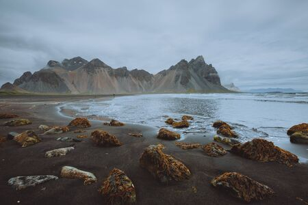 Tranquil landscape of the volcanic beach. Location Stokksnes cape, Vestrahorn  Iceland, Europe. Scenic image of tourist attraction. Travel destination. Discover the beauty of earth. Archivio Fotografico