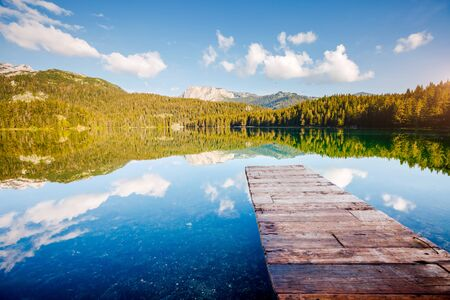 Peaceful view of Black lake. Location National park Durmitor, village Zabljak, Montenegro, Balkans, Europe. Scenic image of travel destination. Wallpaper summer vacation. Discover the beauty of earth. Foto de archivo