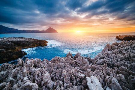 Amazing form of volcanic beach. Location cape San Vito, Monte Cofano, Sicilia, region of Italy, Europe. Mediterranean sea. Scenic image of unique place in world. Discover the beauty of earth.