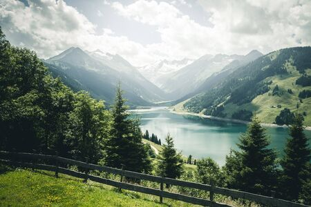 Great panorama of the Durlassboden reservoir. Location municipality of Gerlos, Zillertal valley, Austrian states of Tyrol and Salzburg, Europe, High Tauern National Park. Discover the beauty of earth.