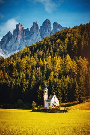 Awesome view San Giovanni Church in St. Magdalena village. Location place is the landmark Val di Funes (Villnob), Dolomite alps, Trentino-Alto Adige, Italy, Europe. Discover the beauty of earth.
