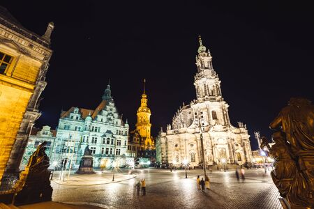 View of cathedral Catholic Hofkirche and palace Georgenbau at old town. Location Dresden, Saxony land, Germany, Europe. Famous tourist attraction. Travel destination. Discover the beauty of earth. Banco de Imagens