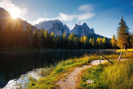 Great rocks over the lake Antorno, National Park Tre Cime di Lavaredo. Location Misurina, Dolomiti alps, Province of Belluno, Italy, Europe. Scenic image of alpine view. Discover the beauty of earth.