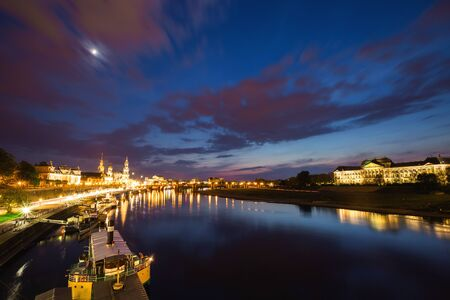 Peaceful view of embankment of the river Elbe. Location place cathedral Hofkirche, Dresden, Saxony land, Germany, Europe. Famous tourist attraction. Travel destination. Discover the beauty of earth.