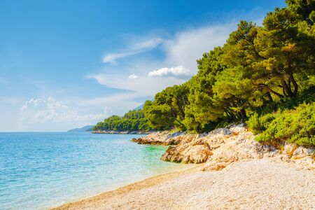Cozy and wild beach with azure water in luxurious lagoon. Location place Croatia, Dalmatia region, Balkans, Europe. Scenic image of popular european travel destination. Discover the beauty of earth.