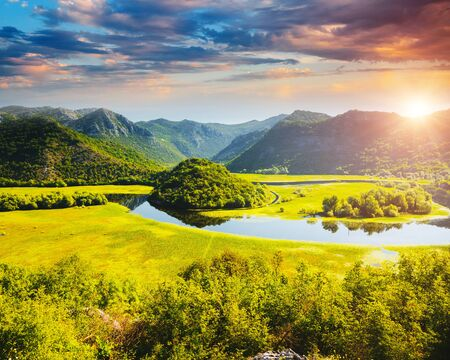 Great view of the Rijeka Crnojevica on a sunny day. Location place National park Skadar Lake, Montenegro, Balkans, Europe. Scenic image of popular vacation destinations. Discover the beauty of earth.
