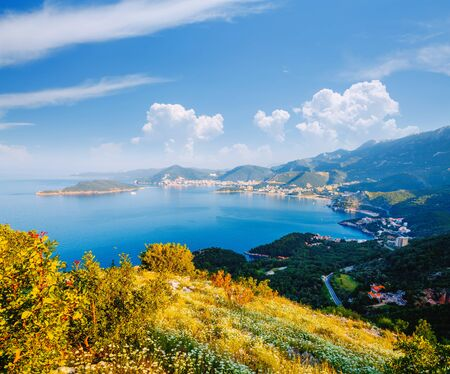 Peaceful view of the Budva Riviera in a beautiful summer day. Location place Sveti Stefan, Montenegro, Balkans, Adriatic sea, Europe. Scenic image of tourist destination. Discover the beauty of earth. Banco de Imagens