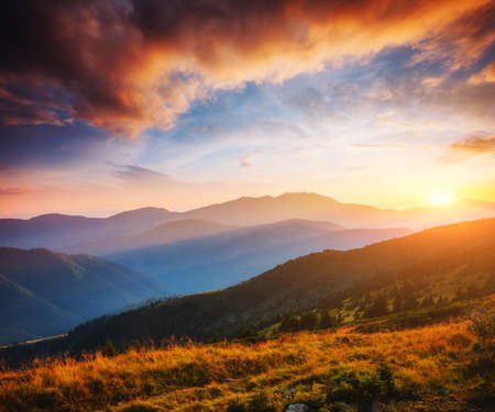 Calm evening landscape in the mountains at sunset. Colorful cloudy sky. Location place of Carpathian national park, Ukraine, Europe. Incredible natural wallpaper. Discover the beauty of earth. Banco de Imagens
