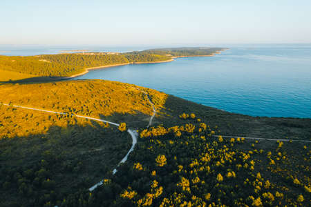 Great view from the top to the shore in evening. Location place Kvarner Gulf, Cres island, Croatia, Europe. Drone photography. Summer vacation concept. Exotic wallpapers. Discover the beauty of earth.