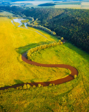 Picturesque top view of the river valley. Location place of Seret canyon, Ukraine, Europe. Drone photography. Fresh seasonal background. Perfect natural wallpaper. Discover the beauty of earth. Banco de Imagens