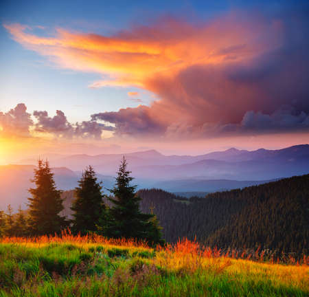 Exotic landscape in the mountains at sunset. Picture of colorful cloudy sky. Location place of Carpathian national park, Ukraine, Europe. Idyllic natural wallpaper. Discover the beauty of earth. Banco de Imagens