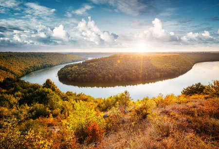 Exotic view of the sinuous river flowing through hills. Location Dnister or Dniestr canyon, Ukraine, Europe. Drone photography. An attractive summer scene on a nice day. Discover the beauty of earth. Standard-Bild