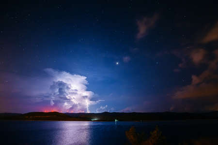 An ominous storm clouds are highlighted by lightning. Location place coast of Croatia, Adriatic Sea, Balkans, Europe. Scenic image of moody weather. Climate change. Discover the beauty of earth.