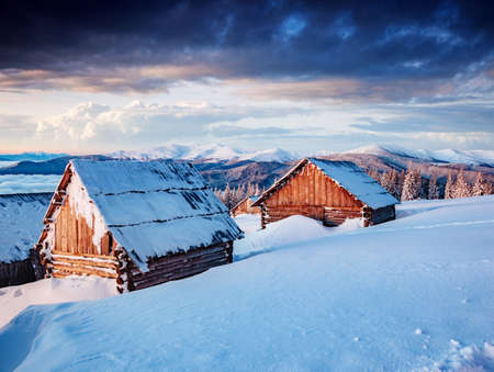 Splendid view of the countryside. Frosty morning in the farm land. Location Carpathian mountains, Ukraine, Europe. Beautiful nature landscape. Excellent winter wallpaper. Explore the beauty of earth.