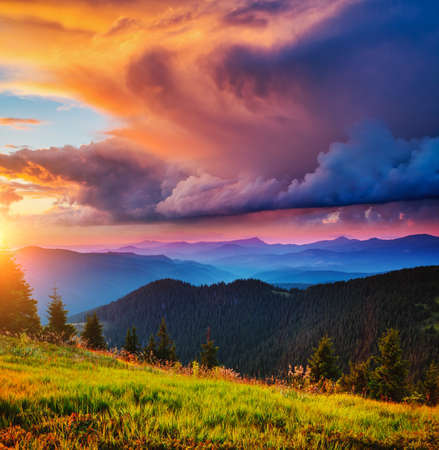 Exotic landscape in the mountains at sunset. Picture of colorful cloudy sky. Location place of Carpathian national park, Ukraine, Europe. Idyllic natural wallpaper. Discover the beauty of earth. Standard-Bild