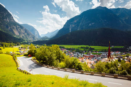 Tranquil summer scene in Oetz village on a sunny day. Location place Austrian Alps, Imst district of Tyrol, Austria, Europe. Scenic image the concept of active travel. Discover the beauty of earth.