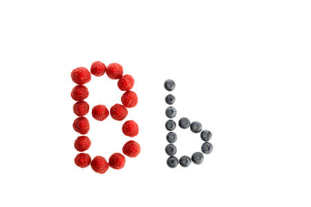 Alphabet B from fresh fruit, raspberry and blackberry, isolated on a white background