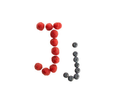 Alphabet J from fresh fruit, raspberry and blackberry, isolated on a white background