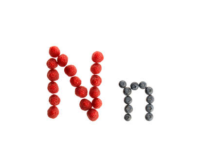Alphabet N from fresh fruit, raspberry and blackberry, isolated on a white background