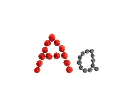 Alphabet A from fresh fruit, raspberry and blackberry, isolated on a white background