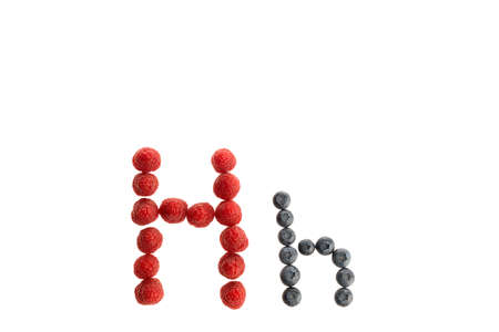 Alphabet H from fresh fruit, raspberry and blackberry, isolated on a white background