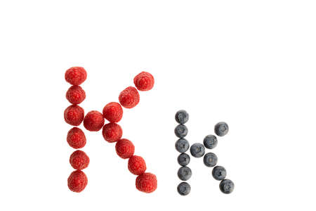 Alphabet K from fresh fruit, raspberry and blackberry, isolated on a white background Imagens