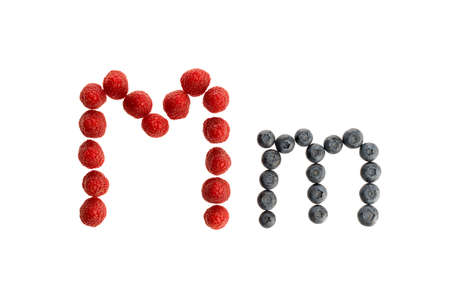 Alphabet M from fresh fruit, raspberry and blackberry, isolated on a white background