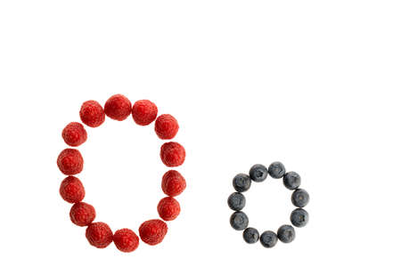 Alphabet O from fresh fruit, raspberry and blackberry, isolated on a white background Imagens