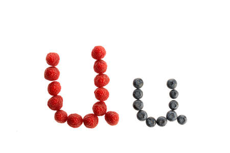 Alphabet U from fresh fruit, raspberry and blackberry, isolated on a white background
