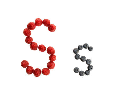 Alphabet S from fresh fruit, raspberry and blackberry, isolated on a white background