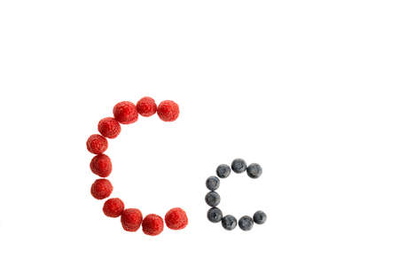 Alphabet C from fresh fruit, raspberry and blackberry, isolated on a white background