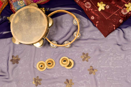 musical instruments of a bellydance percussiongroup with darbukas, tambourines and zills