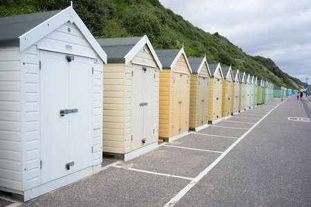 Colorful Beach huts, in beige and white colors, at the boulevard in Bournemouth, Dorset, UK, England on cloudy day in summer Stock fotó