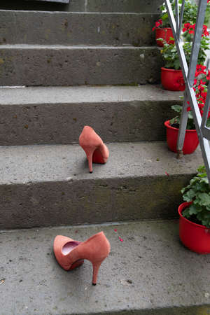 Two red stiletto high heals on the stairs