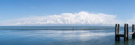 Panorama A Remote floating landing stage for a ferry boat or jetty at a calm sea with an impressinve cloudy sky